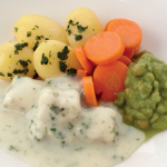 image of Fish in a cheese and herb sauce